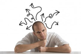 A man thinking with illustrated arrows coming from his head. To illustrate problem solving.