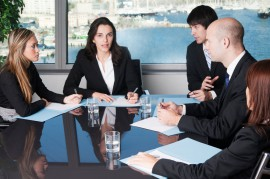 Board room scene with woman in focus